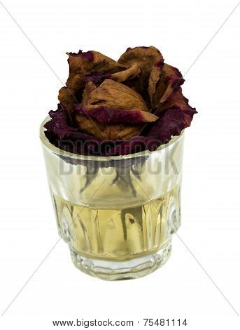 Withered Rose In Glass