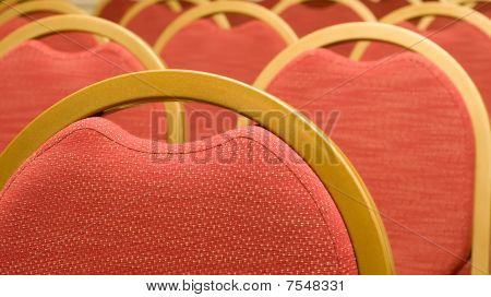 Closeup Of Red Chair In The Conference Hall