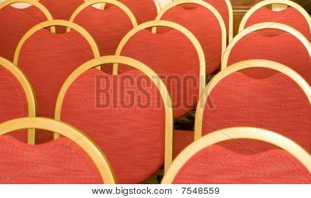 Rows Of Chairs For Visitors In Conference Hall