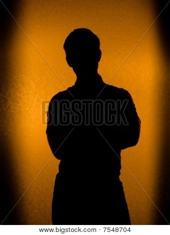Back Lit Silhouette Of Man