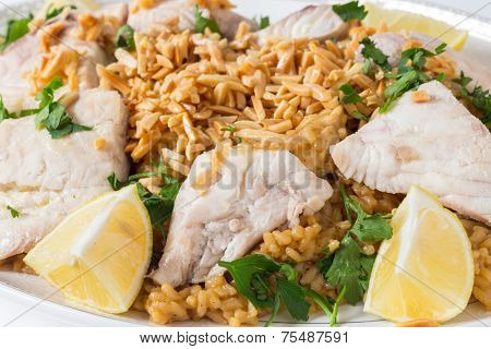 Lebanese-style fried fish served with caramelised onion flavoured rice and roasted almond slivers.
