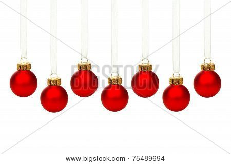 Hanging red Christmas ornaments isolated