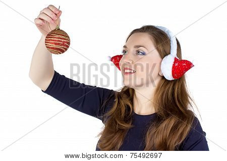 Woman in winter headphones decorating wall