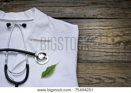 Alternative medicine stethoscope and green symbol  abstract