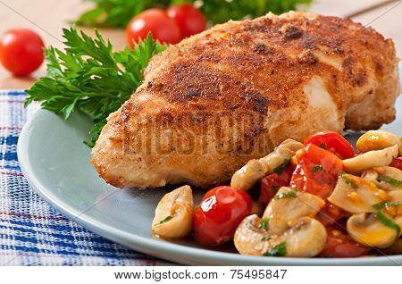Chicken fillet in crispy breadcrumbs garnished with mushrooms and tomatoes