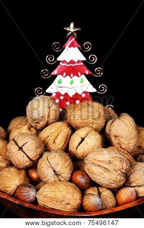 Mixed nuts with tin tree to rear.