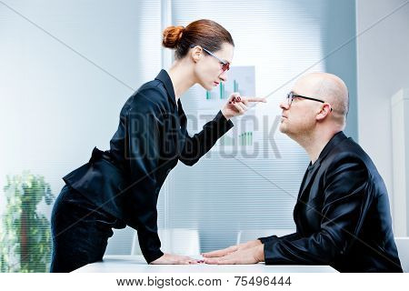 Woman Reproaching Man At Work