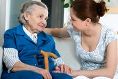 stock photo of disabled person  - nice senior woman with her home caregiver - JPG