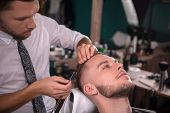 pic of razor  - hairdresser  shaves with blade of razor  face of satisfied  client in  professional  hairdressing salon - JPG
