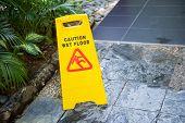 foto of slip hazard  - Sign showing warning of caution wet floor - JPG