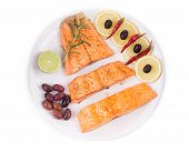 stock photo of kalamata olives  - Fried salmon fillet with kalamata olives - JPG