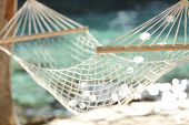 stock photo of rest-in-peace  - Close up of a hammock on a tropical beach resort vacation concept - JPG