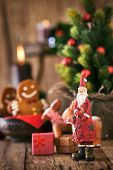 foto of gingerbread man  - Christmas background. Santa Claus with Christmas tree presents and gingerbread man. ** Note: Shallow depth of field - JPG