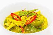 foto of curry chicken  - green curry with chicken in white bowl