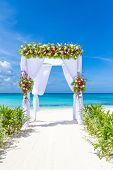 picture of cabana  - wedding arch and set up on beach - JPG