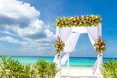 pic of cabana  - wedding arch and set up on beach - JPG