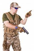 image of glock  - Soldier man holding his gun - JPG