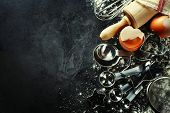 stock photo of sprinkling  - baking background with eggshell and rolling pin - JPG