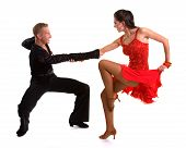 picture of ballroom dancing  - Young ballroom dancers in formal costumes posing against a solid background in a studio - JPG