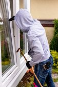 picture of offensive  - a burglar tried to break at an open window with a crowbar - JPG