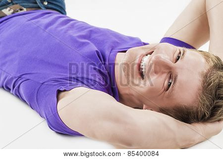 Lifestyle Concept: Closeup Of  Young Smiling Happy Caucasian Handsome Man Lying On Floor And Laughin