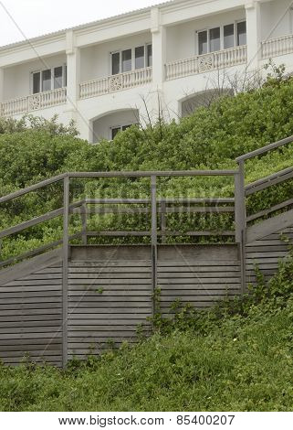 Old Grey Stairs Leading To Hotel