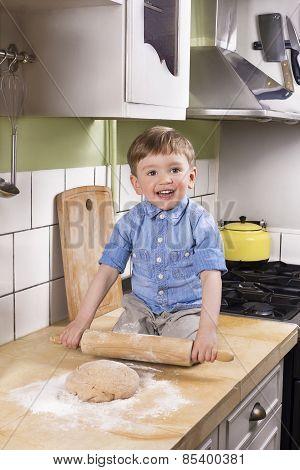 Cute Boy Rolling Dough