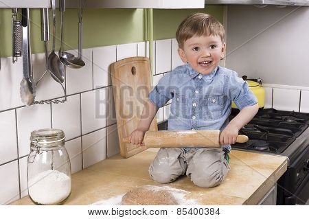 Cute Little Boy Making Pizza