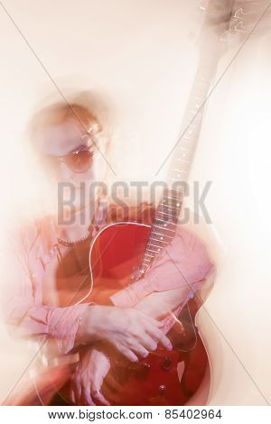 Guitar Player With Acoustic Guitar. Shot With Combination Of Strobes And Halogen Light To Create Moo