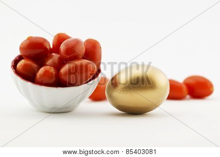 Gold Egg With Red Tomatoes