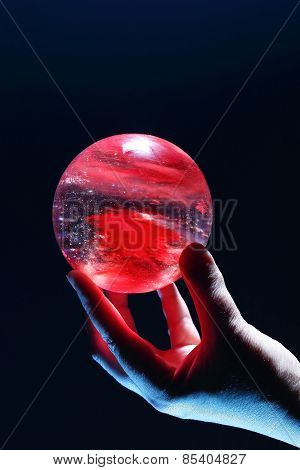 Female hand holding a Crystal Ball