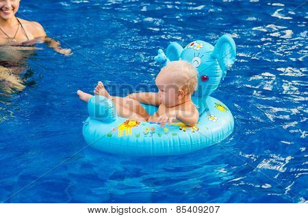 Little child swimming in the pool