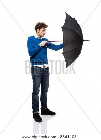 Full length portrait of a man standing with umbrella