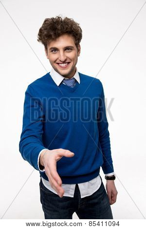 Smiling buisnessman with open hand ready for handshake