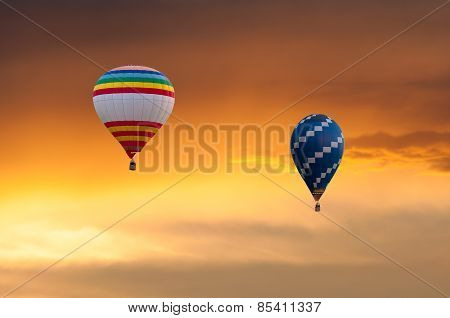 Two Hot Air Balloons in Flight on sunset sky background. Festival of colored balloons. Outdoor, Colo