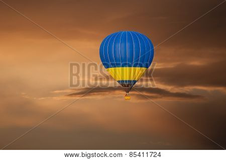 Yellow blue Hot Air Balloon in Flight on sunset sky background. Festival of colored balloons. Outdoo