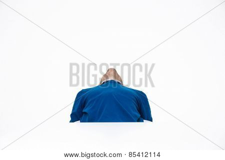 Man sitting at the table and looking up over white background