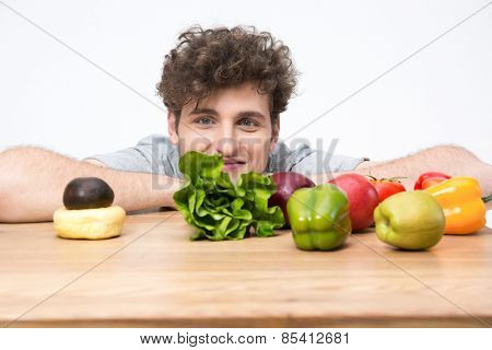 Young man sitting at the table with food