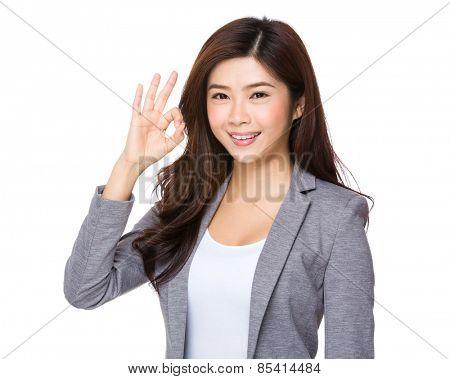 Pretty Businesswoman with ok sign