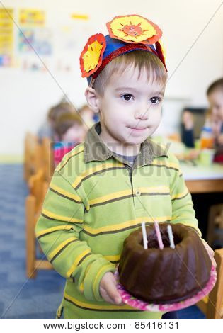 Little cute boy having birthday party at kindergarden