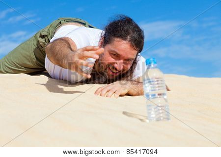 thirsty man reaches for a bottle of water in the empty
