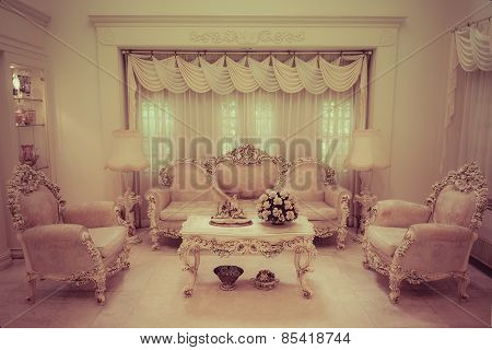 A living room with a luxurious and classical style in retro color.