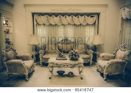 A living room with a luxurious and classical haunting retro style