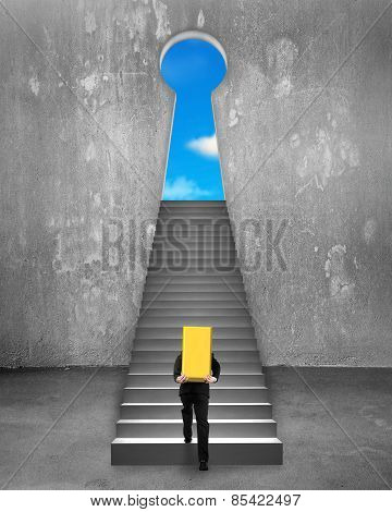 Businessman Carrying Gold Bullion On Stairs To Key Shape Door