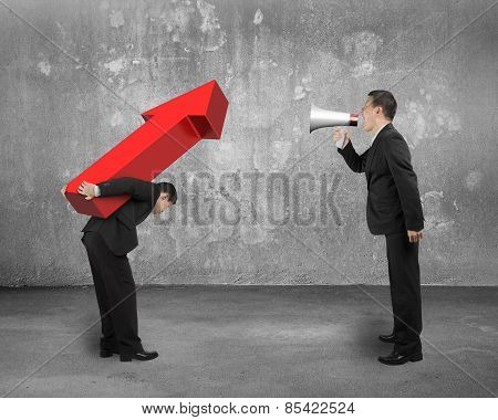 Boss Using Megaphone Shouting At Employee Carrying Red Arrow Sign