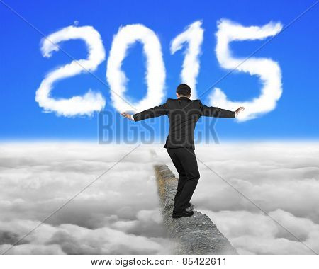 Businessman Balancing On Concrete Ridge With White 2015 Shape Cloud