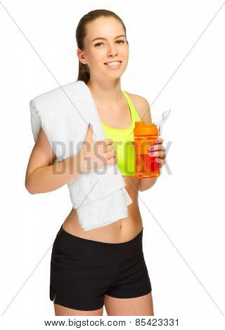 Young sporty girl with bottle and towel isolated