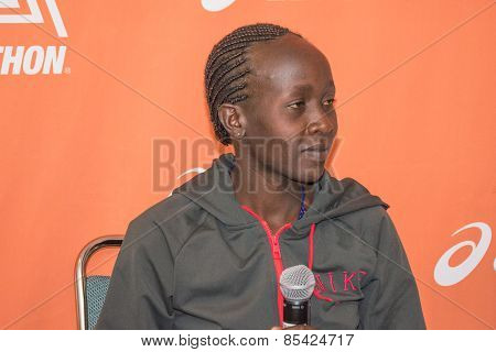 Ogla Kimaiyo, Kenyan Marathon Runner Attends A Press Conference