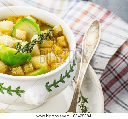 Homemade soup with brussels sprouts and croutons