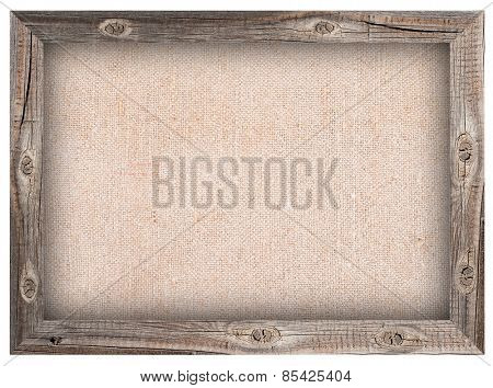Old wooden frame with burlap background